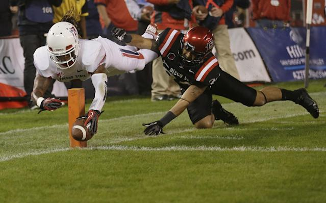 Fresno State wide receiver Isaiah Burse, left, dives in for a touchdown as San Diego State defensive back Rene Siluano, right, can't stop him during the first half in an NCAA college football game Saturday, Oct. 26, 2013, in San Diego. (AP Photo/Gregory Bull)