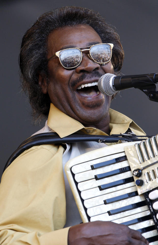 "FILE - In this May 6, 2011 file photo, Buckwheat Zydeco performs at the'New Orleans Jazz and Heritage Festival in New Orleans. Stanley ""Buckwheat"" Dural Jr., who introduced zydeco music to the world through his namesake band Buckwheat Zydeco, has died. He was 68. His longtime manager Ted Fox told The Associated Press that Dural died early Saturday, Sept. 24, 2016. He had suffered from lung cancer.(AP Photo/Patrick Semansky)"