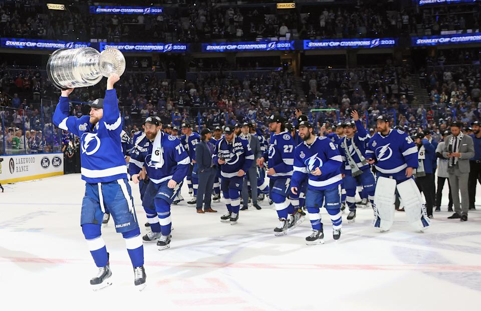 TAMPA, FLORIDA - JULY 07: Steven Stamkos #91 of the Tampa Bay Lightning leads the team around the ice with the Stanley Cup following the victory over the Montreal Canadiens in Game Five of the 2021 NHL Stanley Cup Final at the Amalie Arena on July 07, 2021 in Tampa, Florida. The Lightning defeated the Canadiens 1-0 to take the series four games to one. (Photo by Bruce Bennett/Getty Images)