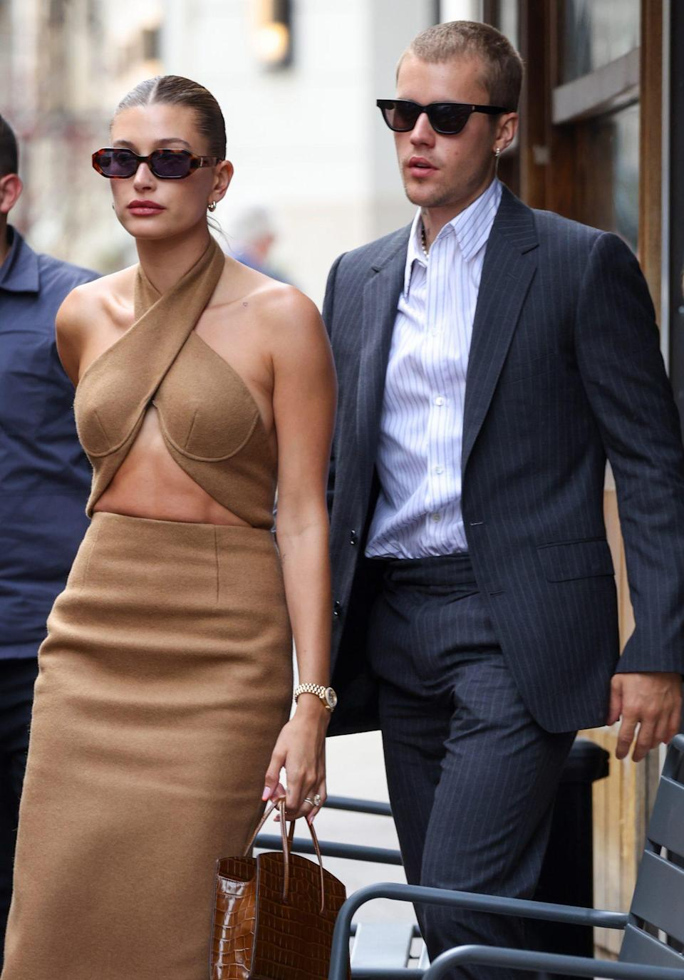 <p>Hailey and Justin Bieber look chic in formal looks as they leave a restaurant in Paris on June 21.</p>