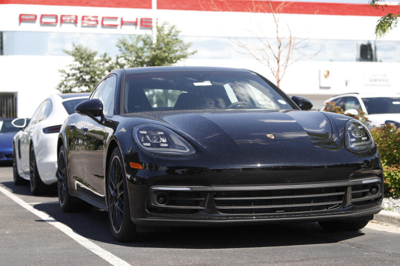 FILE--In this Sunday, July 28, 2019, file photograph, unsold 2019 Porsche Panamera sedan sits at a dealership in Littleton, Colo. (AP Photo/David Zalubowski, File)