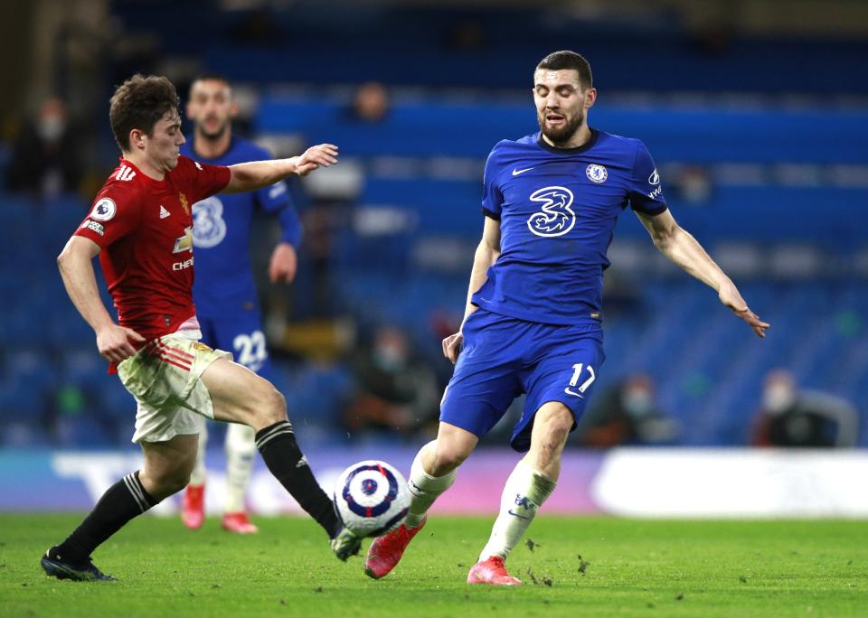 Chelsea's Mateo Kovacic, right, and Manchester United's Victor Lindelof challenge for the ball during the English Premier League soccer match between Chelsea and Manchester United at Stamford Bridge Stadium in London, England, Sunday, Feb. 28, 2021. (AP Photo/Ian Walton, Pool)