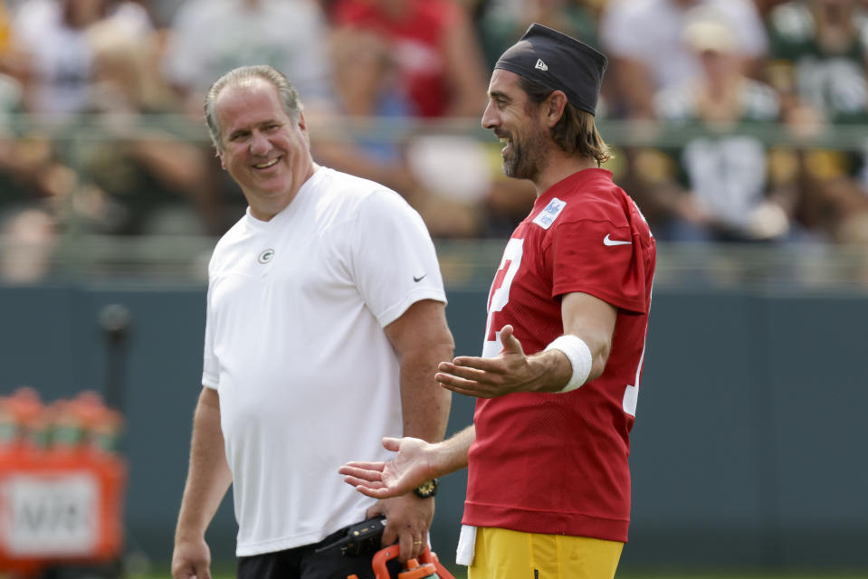 CORRECTS MONTH TO JULY, NOT AUG. - Green Bay Packers' quarterback Aaron Rodgers has a laugh with assistant athletic trainer Kurt Fielding during NFL football training camp Wednesday, July 28, 2021, in Green Bay, Wis. (AP Photo/Matt Ludtke)
