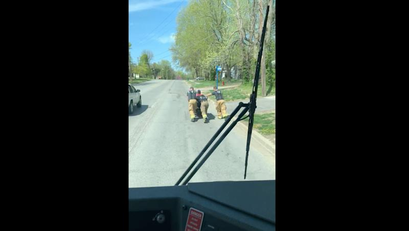 Three firemen in Missouri pushed home a disabled veteran in 80-degree weather when his wheelchair malfunctioned. (Screenshot: Facebook/Raytown Fire Protection District)