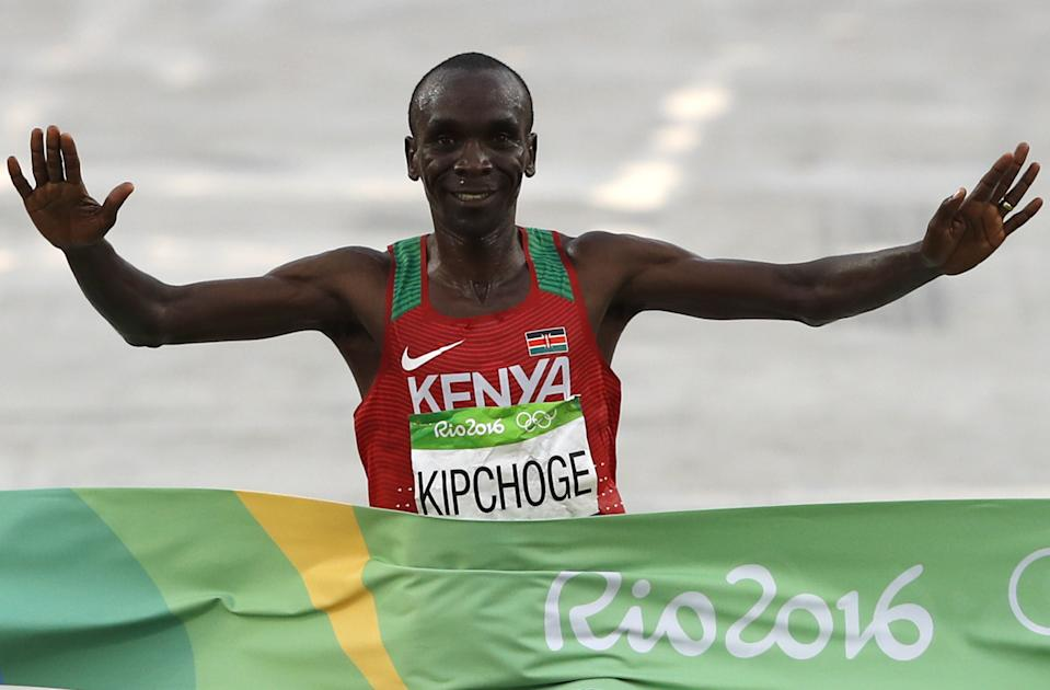 Kenya's Eliud Kipchoge crosses the finish line to win the Men's Marathon athletics event of the Rio 2016 Olympic Games at the Sambodromo in Rio de Janeiro on August 21, 2016.   / AFP / Adrian DENNIS        (Photo credit should read ADRIAN DENNIS/AFP via Getty Images)