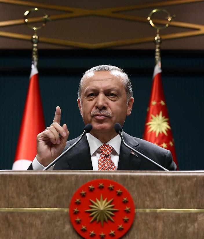 Turkish President Recep Tayyip Erdogan has said that the EU is not upholding its side of the bargain in the controversial migrant deal signed in March (AFP Photo/Yasin Bulbul)