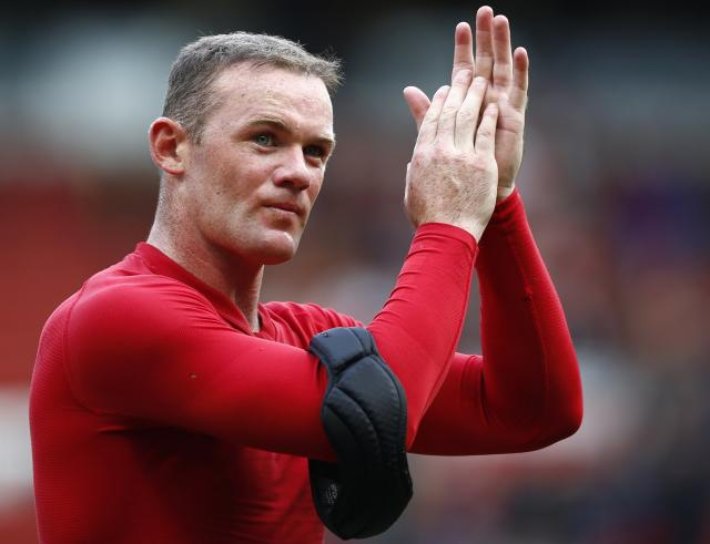 Manchester United's Rooney applauds after their English Premier League soccer match against Crystal Palace in Manchester
