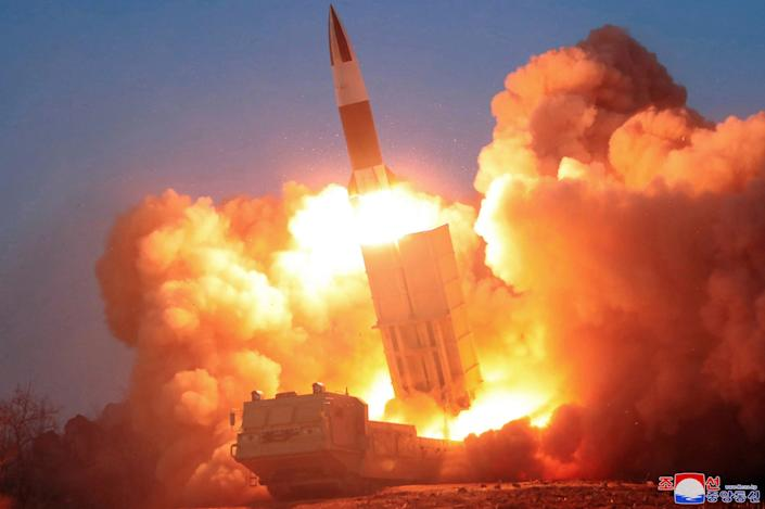 A rocket launches at an undisclosed location in North Korea on March 21, 2020.