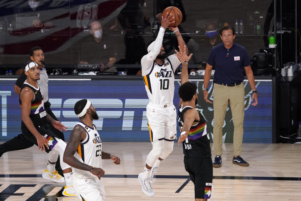 Utah Jazz's Mike Conley (10) attempts a shot in the final seconds against the Denver Nuggets. (AP Photo/Mark J. Terrill)