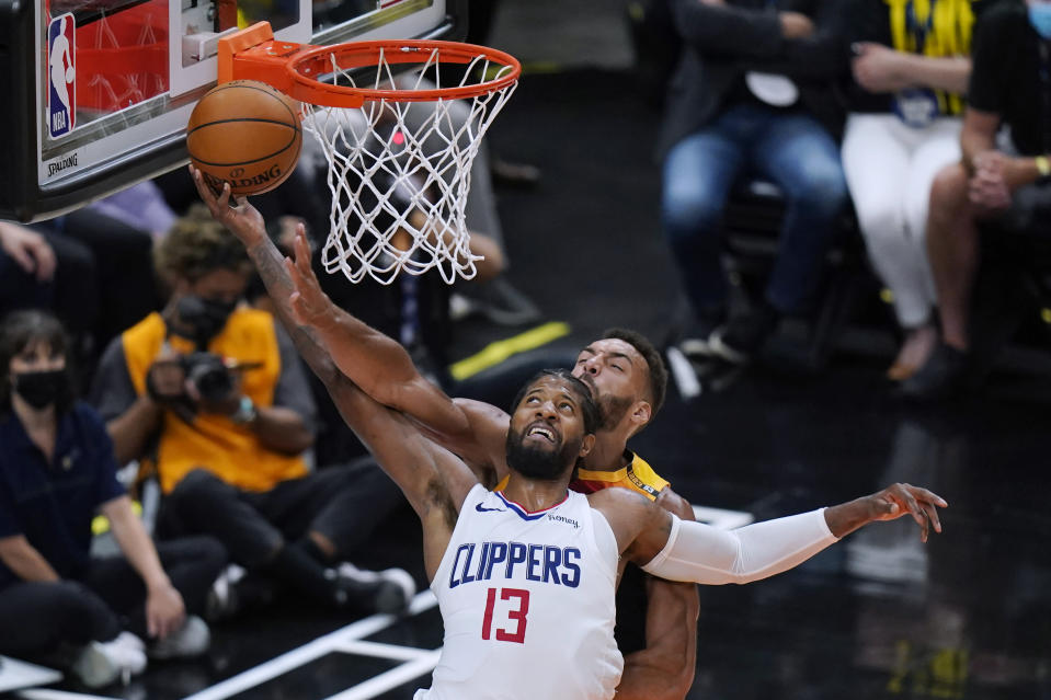 Utah Jazz center Rudy Gobert, rear, defends against Los Angeles Clippers guard Paul George (13) during the second half of Game 5 of a second-round NBA basketball playoff series Wednesday, June 16, 2021, in Salt Lake City. (AP Photo/Rick Bowmer)