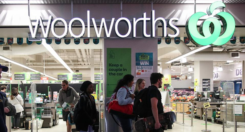 Front of Woolworths store with people walking past.