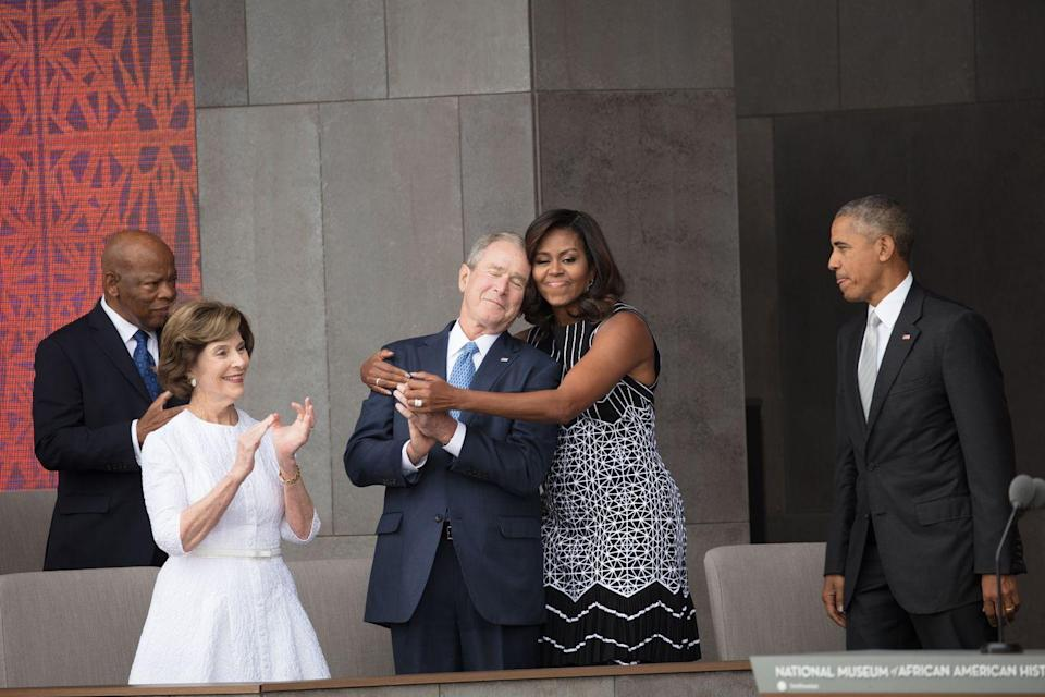 <p>First Lady Michelle Obama hugs former President George W. Bush at the opening of the National Museum of African American History and Culture in Washington, DC, on September 24, 2016.</p>