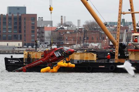 The wreckage of a chartered Liberty Helicopters helicopter that crashed into the East River is hoisted from the water in New York, U.S., March 12, 2018. REUTERS/Shannon Stapleton