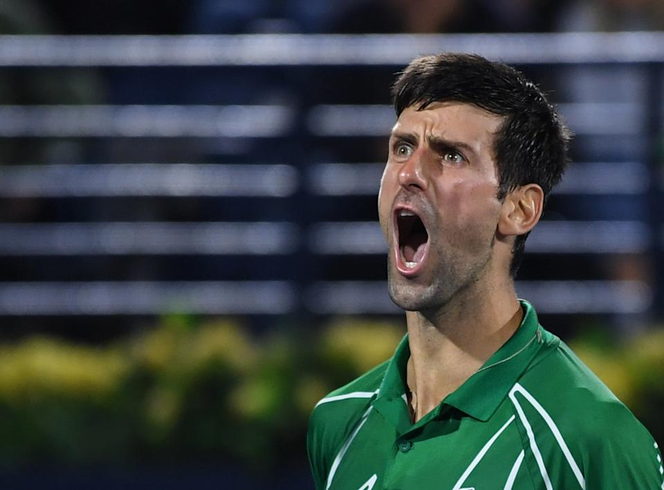 Novak Djokovic of Serbia celebrates after winning the final of the Dubai Duty Free Tennis Championship in the Gulf emirate of Dubai on February 29, 2020. (Photo by KARIM SAHIB / AFP) (Photo by KARIM SAHIB/AFP via Getty Images)