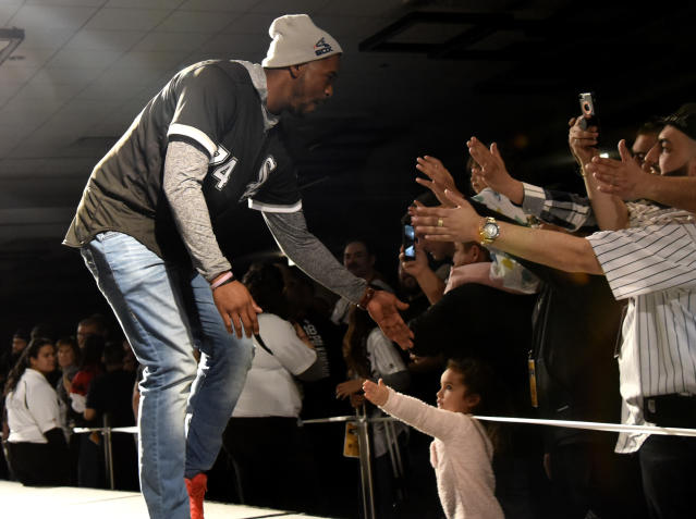 Chicago White Sox's Eloy Jimenez is introduced to fans during the baseball team's convention Friday, Jan. 25, 2019, in Chicago. (AP Photo/David Banks)