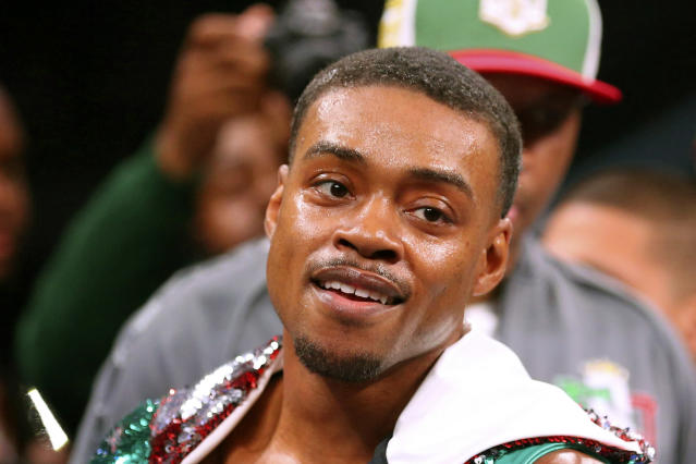 FILE - In this March 16, 2019, file photo, Errol Spence Jr. gestures for the TV cameras before an IBF World Welterweight Championship boxing bout against Mikey Garcia, in Arlington, Texas. Authorities say welterweight boxing champion Errol Spence crashed a speeding Ferrari in Dallas and is badly injured but expected to survive. Police say the crash happened just before 3 a.m. Thursday, Oct. 10, 2019, when Spence's Ferrari crossed the median into oncoming traffic and flipped over several times.Spence was taken to a hospital where he was in the intensive care unit Thursday morning. (AP Photo/Richard W. Rodriguez, File)