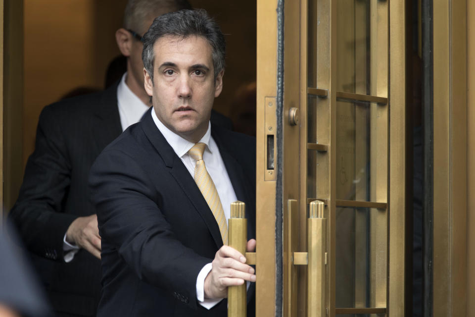 FILE - In this Aug. 21, 2018, file photo, Michael Cohen leaves federal court, in New York. More than two weeks after Donald Trump left the White House, federal prosecutors in New York have not revived the campaign finance investigation that dogged his presidency and sent his former attorney Michael Cohen to prison, according to several people familiar with the case. (AP Photo/Mary Altaffer, File)