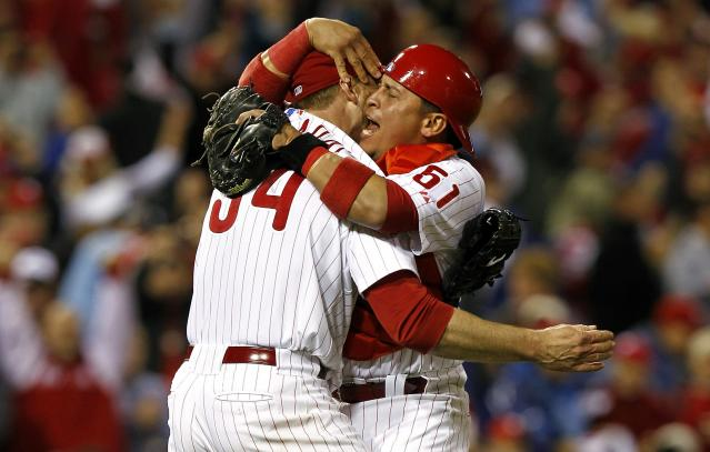 PHILADELPHIA - OCTOBER 06: Roy Halladay #34 and Carlos Ruiz #51 of the Philadelphia Phillies celebrate Halladay's no-hitter and the win in Game 1 of the NLDS against the Cincinnati Reds at Citizens Bank Park on October 6, 2010 in Philadelphia, Pennsylvania. (Photo by Jeff Zelevansky/Getty Images)
