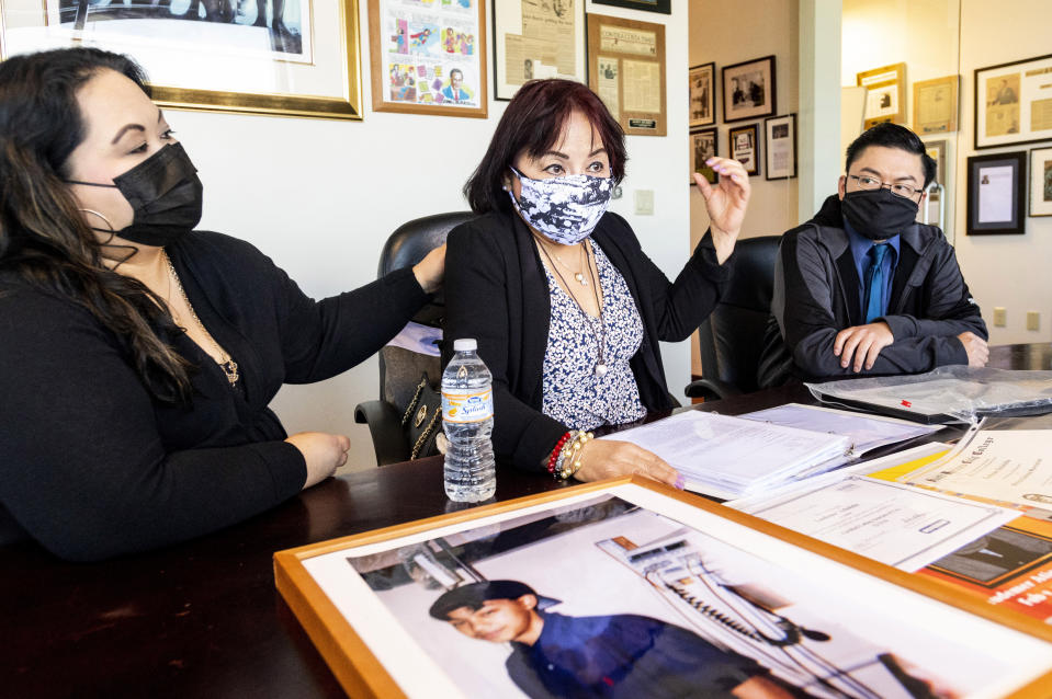 Jeannie Atienza discusses the death of her son Laudemer Arboleda while seated with daughter Jennifer Leong and son Randy Arboleda on Monday, May 3, 2021, in Oakland, Calif. Danville police officer Andrew Hall faces felony charges for shooting and killing Arboleda during a 2018 car chase. This and another fatal shooting by the same police officer in a wealthy San Francisco suburb have cast a spotlight on what criminal justice activists are calling a case of delayed justice and its deadly consequences. (AP Photo/Noah Berger)