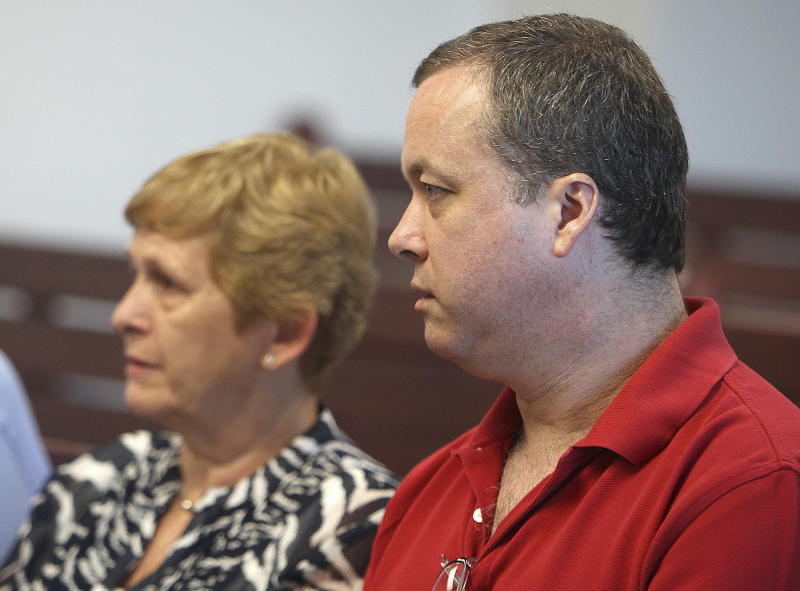 Mark Kerrigan, brother of ice skater Nancy Kerrigan, sits with his mother, Brenda Kerrigan, left, during a hearing at Middlesex Superior Court  in Woburn, Mass., Wednesday, Aug. 8, 2012.  A judge denied Kerrigan's request to return to prison, to serve the last four months of his 2 1/2-year sentence for assault and battery in connection with his father's 2010 death, rather than comply with conditions of his probation.   (AP Photo/Boston Herald, Angela Rowlings, Pool)