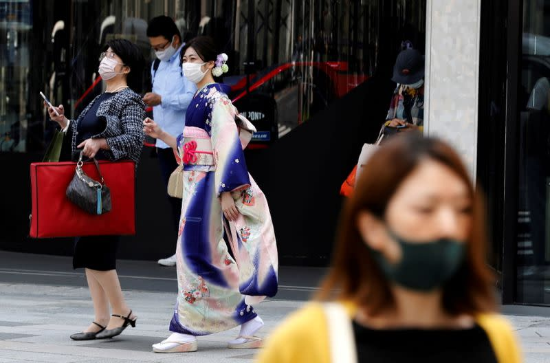 FILE PHOTO: The first day of Japan's third state of emergency in Tokyo