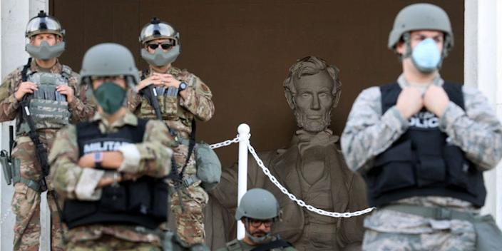 Members of the DC National Guard stand on the steps of the Lincoln Memorial monitoring demonstrators during a peaceful protest against police brutality and the death of George Floyd, on June 2, 2020 in Washington, DC.