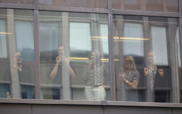 <p>Office workers look on from a building next to the Labour Party's Headquarters in London, Britain June 9, 2017. (Photo: Marko Djurica/Reuters) </p>