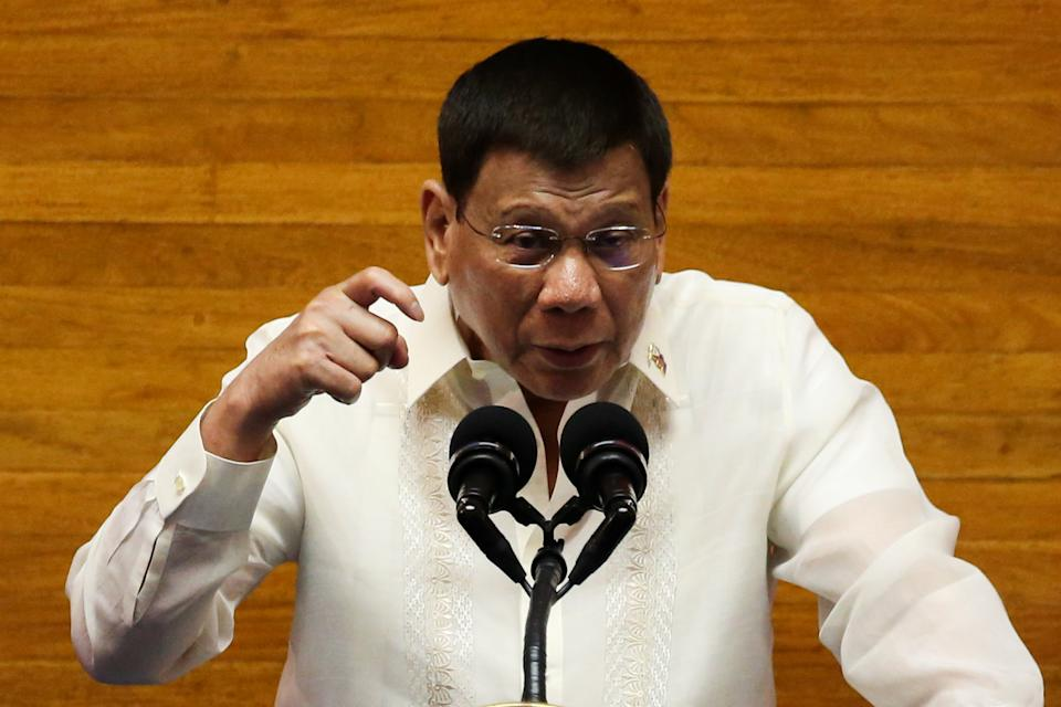 FILE PHOTO: President Rodrigo Duterte gestures as he delivers his 6th State of the Nation Address (SONA), at the House of Representatives July 26, 2021. (Source: REUTERS/Lisa Marie David)