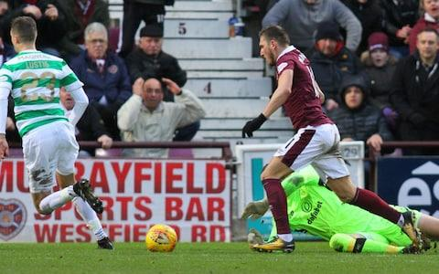 Craig Gordon is beaten by David Milinkovic for the Hearts 3rd goal  - Credit: Vagelis Georgariou/Action Plus /Getty Images