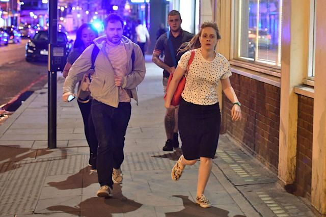 "<p>People run down Borough High Street as police are dealing with a ""major incident"" at London Bridge. (Dominic Lipinski/PA Images via Getty Images) </p>"