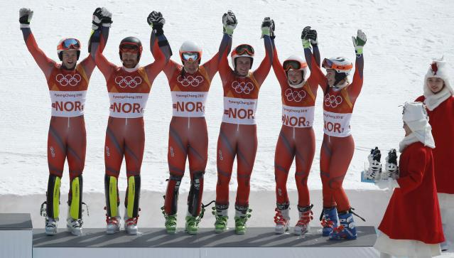 Alpine Skiing - Pyeongchang 2018 Winter Olympics - Team Event - Yongpyong Alpine Centre - Pyeongchang, South Korea - February 24, 2018 - Bronze medallist Norway's team celebrates on the podium during the victory ceremony. REUTERS/Mike Segar