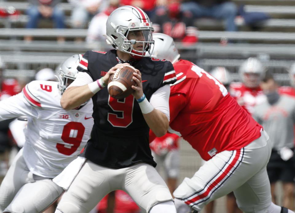 Ohio State quarterback Jack Miller drops back to pass during the Buckeyes' spring NCAA college spring football game in Columbus, Ohio, Saturday, April 17, 2021. (AP Photo/Paul Vernon)