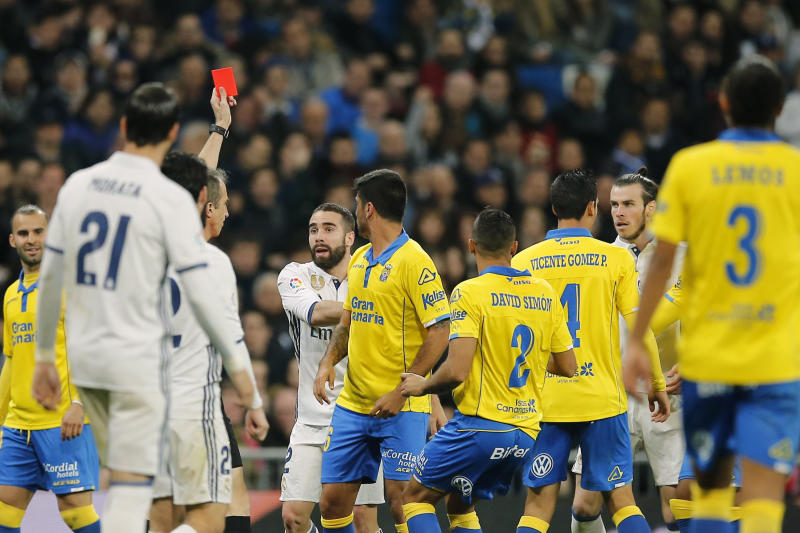 The referee shows a red card to Real Madrid's Gareth Bale, 2nd right, during a Spanish La Liga soccer match between Real Madrid and Las Palmas at the Santiago Bernabeu stadium in Madrid, Spain, Wednesday March 1, 2017. (AP Photo/Paul White)