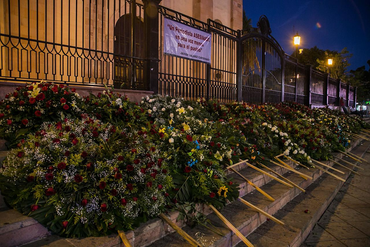 <p>Flower arrangements cover the steps of the Cathedral of Culiacan Mexico after the funeral mass of slain journalist Javier Valdez, Tuesday, May 16 2017. (AP Photo/Rashide Frias) </p>