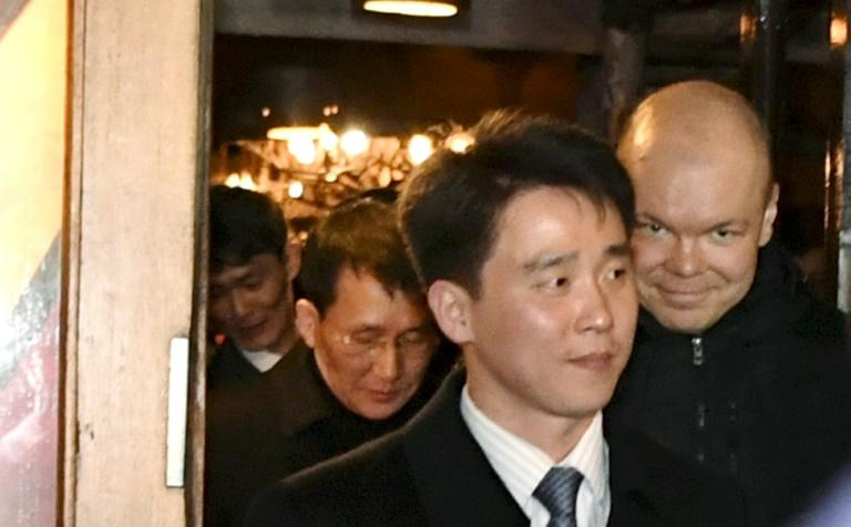Senior North Korean diplomat Choe Kang Il (in background) emerges from a restaurant in Helsinki, part of intense diplomacy over the Korean peninsula