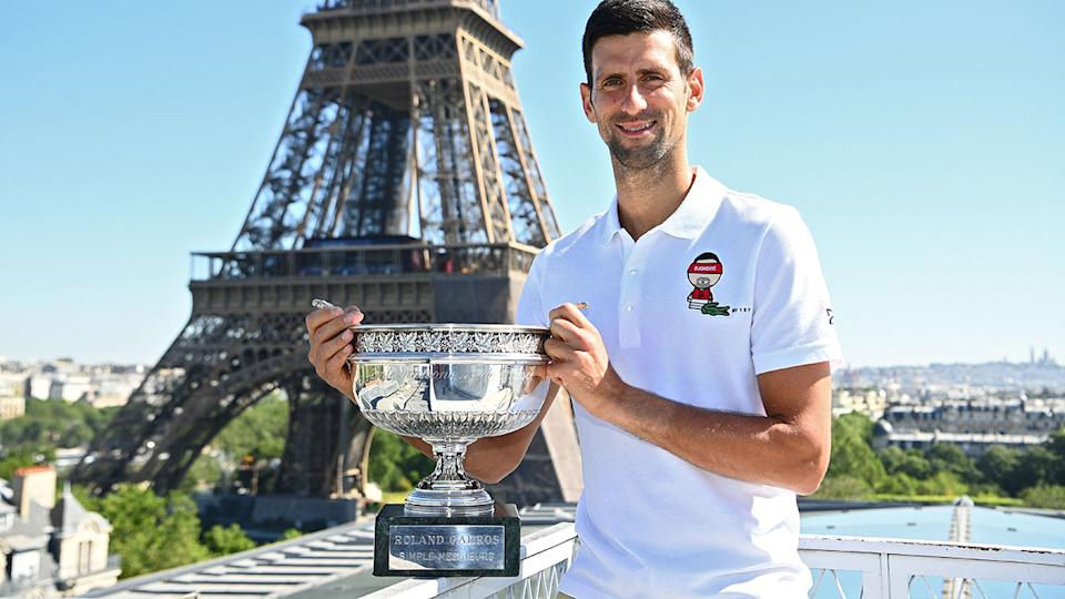 Novak Djokovic, pictured here with the French Open trophy in front of the Eiffel tower.