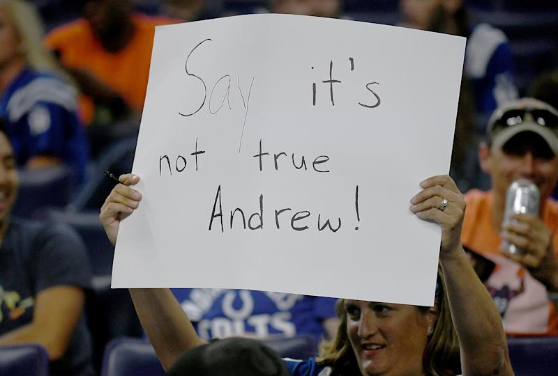 INDIANAPOLIS, IN - AUGUST 24: An Indianapolis Colts fan holds up a sign after Adam Schefter tweeted that Andrew Luck was planning on retiring during the fourth quarter of the game between the Chicago Bears and the Indianapolis Colts at Lucas Oil Stadium on August 24, 2019 in Indianapolis, Indiana. (Photo by Bobby Ellis/Getty Images)