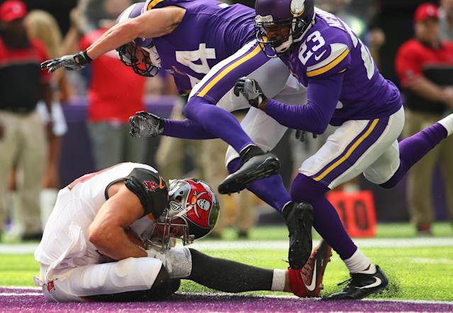 <p>Cameron Brate #84 of the Tampa Bay Buccaneers catches a 15 yard touchdown pass in the third quarter of the game against the Minnesota Vikings on September 24, 2017 at U.S. Bank Stadium in Minneapolis, Minnesota. (Photo by Adam Bettcher/Getty Images) </p>