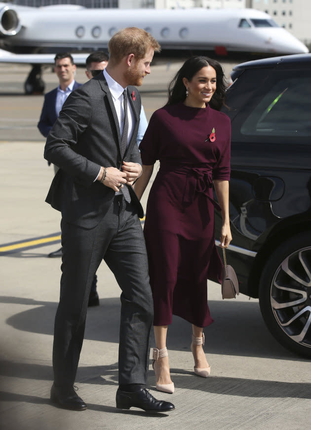 Prince Harry and Meghan Markle arrive at the airport following the Invictus Games in Sydney on Oct. 28, 2018.