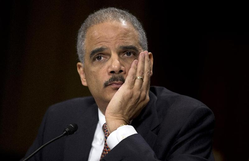 "Attorney General Eric Holder listens as he testifies on Capitol Hill in Washington, Wednesday, March 6, 2013, before the Senate Judiciary Committee hearing: ""Oversight of the U.S. Department of Justice."" Holder urged Congress to confront gun violence by requiring universal background checks, imposing tougher penalties on traffickers and banning high-capacity magazines and military-style assault weapons. (AP Photo/Evan Vucci)"