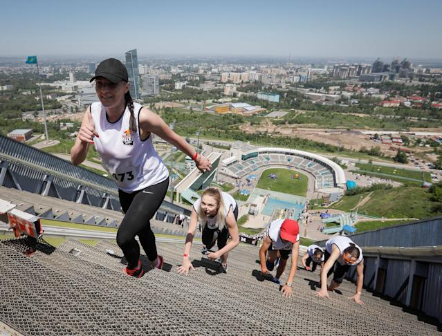 Athletes compete during the Red Bull 400 uphill sprint at the Sunkar International Ski Jumping Complex in Almaty, Kazakhstan May 20, 2018. REUTERS/Shamil Zhumatov
