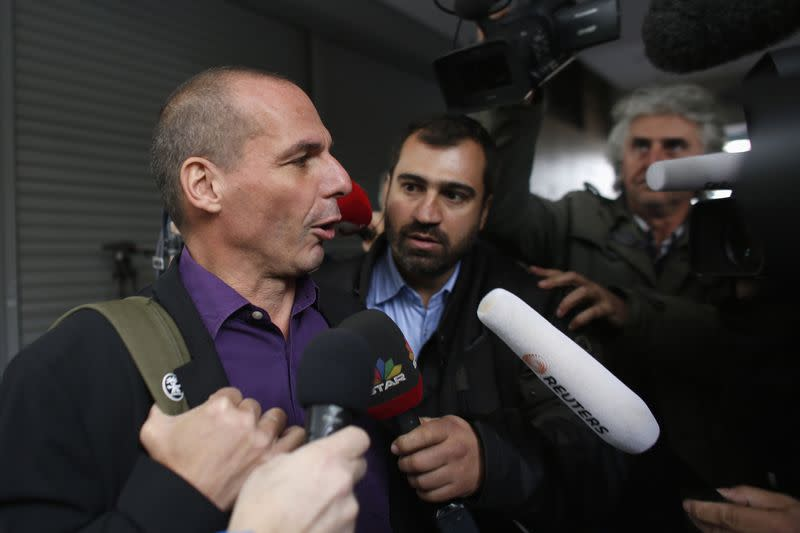 Greek Finance Minister Yanis Varoufakis speaks to reporters as he arrives at the ministry to meet with the U.S. delegation, in Athens
