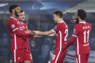 Liverpool's Diogo Jota, center, celebrates after scoring his second goal against Atalanta during the Champions League, group D soccer match between Atalanta and Liverpool, at the Gewiss Stadium in Bergamo, Italy, Tuesday, Nov. 3, 2020. (Stefano Nicoli/LaPresse via AP)