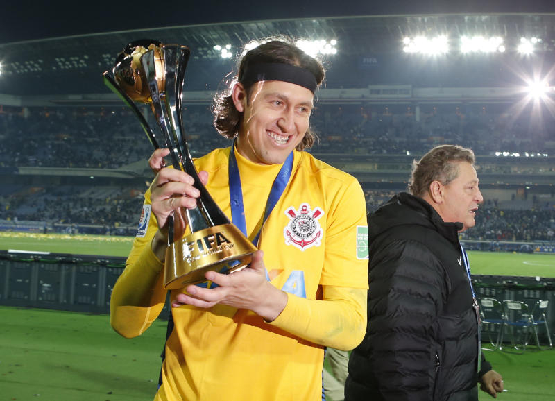 Corinthians' goalkeeper Cassio holds the trophy at the end of the final at the FIFA Club World Cup soccer tournament in Yokohama, near Tokyo, Sunday, Dec. 16, 2012. Corinthians beat Chelsea FC, 1-0. (AP Photo/Shuji Kajiyama)