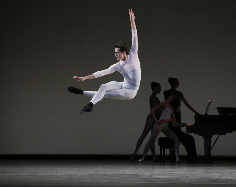 """In this undated photo provided by the New York City Ballet, Robert Fairchild performs in """"In Creases"""" by choreographer Justin Peck which is being performed by the New York City Ballet in New York. (AP Photo/New York City Ballet, Paul Kolnik)"""