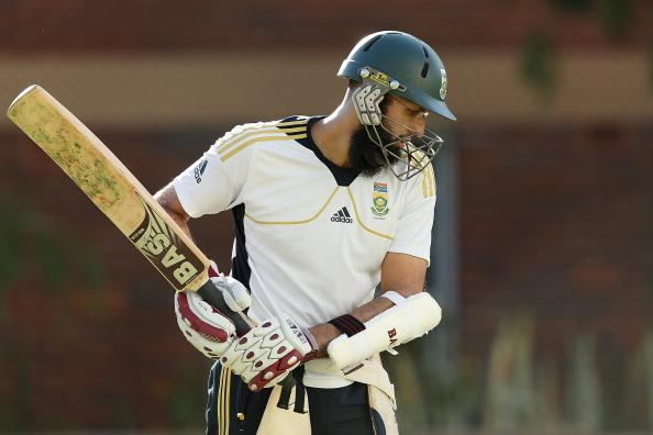 BRISBANE, AUSTRALIA - NOVEMBER 07:  Hashim Amla prepares to bat during a South African nets session at The Gabba on November 7, 2012 in Brisbane, Australia.  (Photo by Chris Hyde/Getty Images)