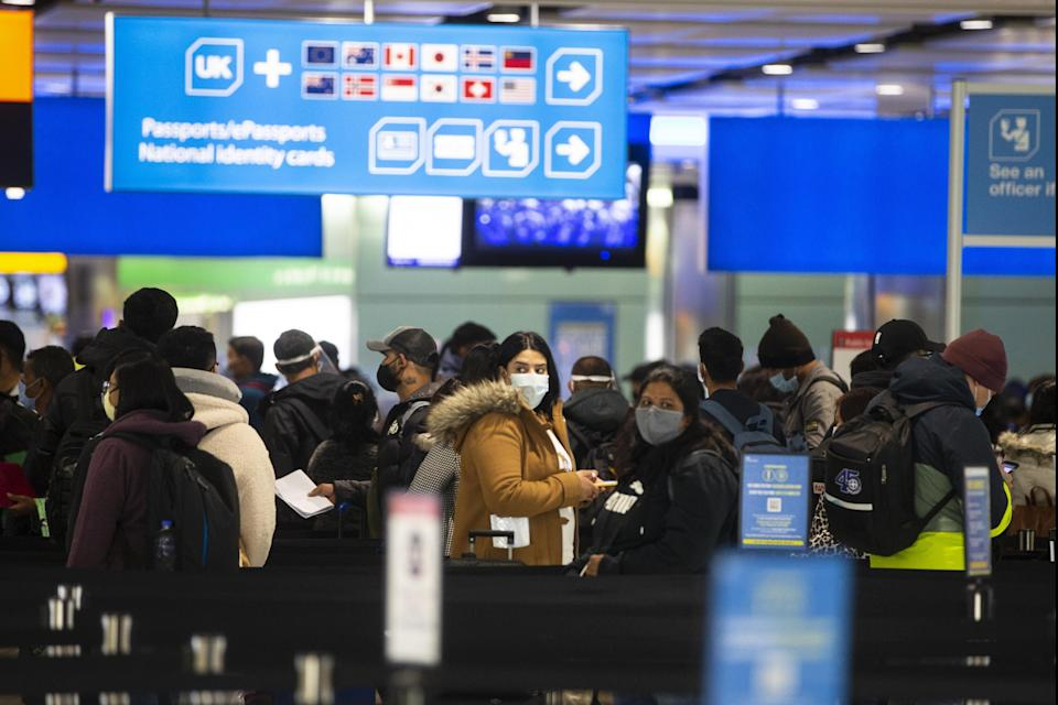 <p>In and out: border control at Heathrow</p> (Getty Images)