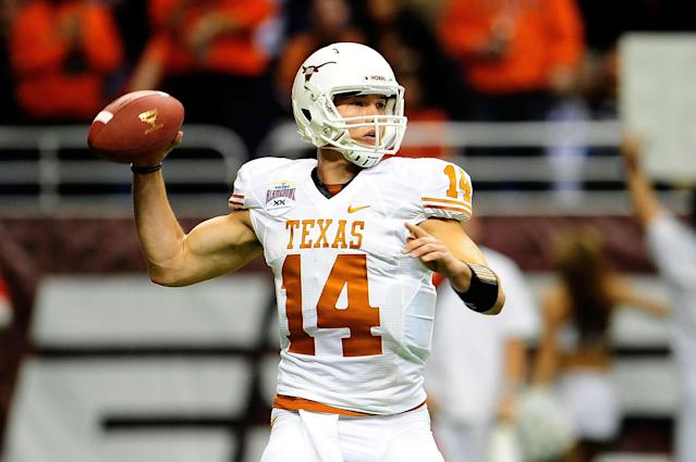 SAN ANTONIO, TX - DECEMBER 29: David Ash #14 of the University of Texas Longhorns drops back to pass against the Oregon State Beavers during the Valero Alamo Bowl at the Alamodome on December 29, 2012 in San Antonio, Texas. Texas won the game 31-27. (Photo by Stacy Revere/Getty Images)