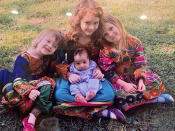 In this undated photo provided by Ryan Brummond, U.S. Special Forces Officer Ryan Brummond's daughters pose with an Afghan interpreter's son wearing dresses that were gifted to them by Mohammad Khalid Wardak to celebrate the collective relationship between the men. Khalid, as he's called by his friends, had no intention of leaving Afghanistan, where he was a high-profile national police officer who'd worked alongside American special forces to defeat the Taliban. Then with stunning speed, his government collapsed. Now he is in hiding with his wife and four children, wounded and hunted by the Taliban, desperately hoping that American officials will repay his loyalty by helping his family escape almost certain death. (Ryan Brummond via AP)