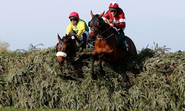 """<span class=""""element-image__caption"""">Davy Russell and Tiger Roll clear the final fence in 2019 on the way to back-to-back Grand National wins.</span> <span class=""""element-image__credit"""">Photograph: Alex Livesey/Getty Images</span>"""